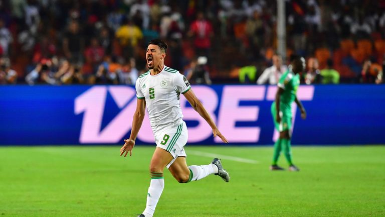 Algeria's forward Baghdad Bounedjah celebrates after scoring a goal during the 2019 Africa Cup of Nations (CAN) Final football match between Senegal and Algeria at the Cairo International Stadium in Cairo on July 19, 2019. (Photo by Giuseppe CACACE / AFP) (Photo credit should read GIUSEPPE CACACE/AFP/Getty Images)