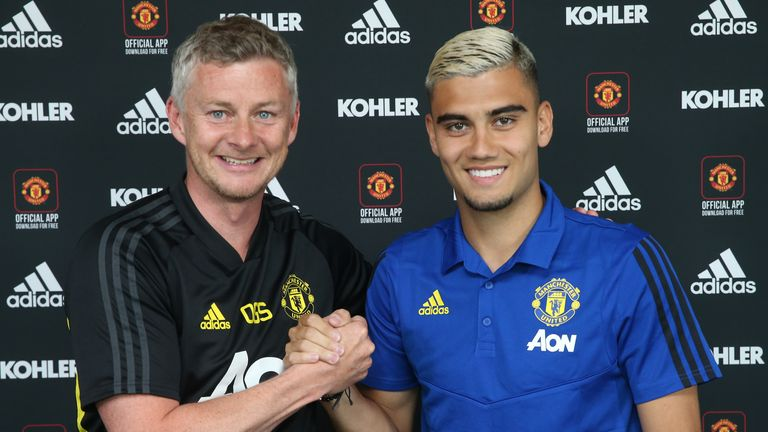 Andreas Pereira poses with Ole Gunnar Solskjaer after signing a new four-year contract with Manchester United