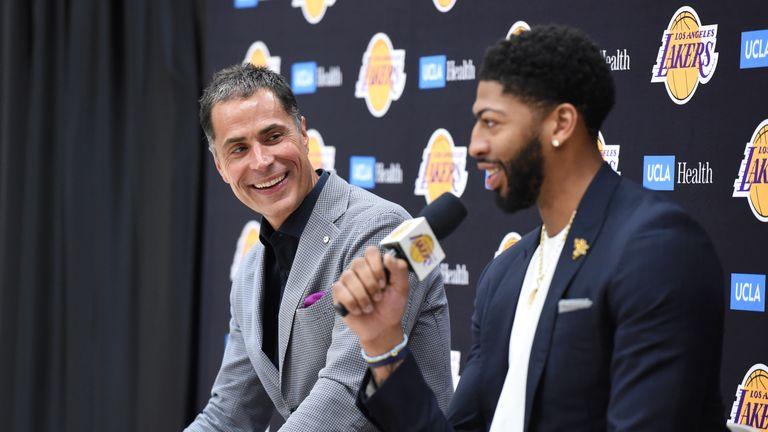 Lakers GM Rob Pelinka looks on as Anthony Davis answers a question