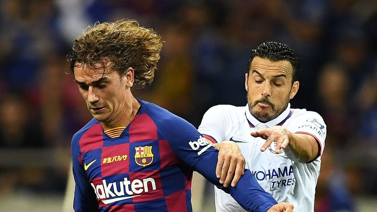 Barcelona forward Antoine Griezmann battles Pedro for the ball