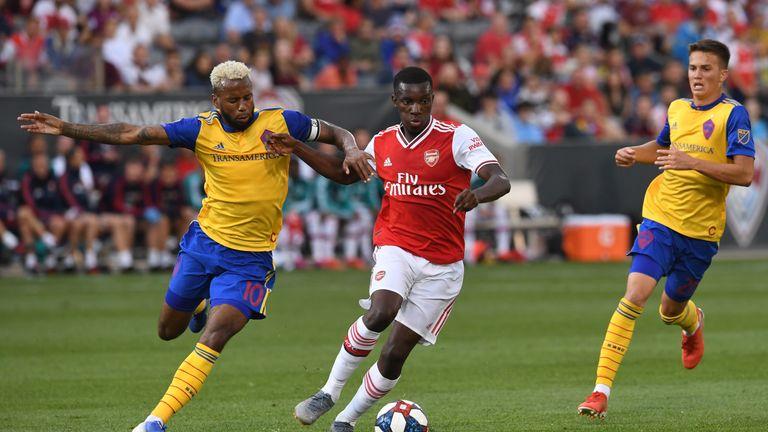 Eddie Nketiah (r) of Arsenal holds off Tyreece John-Jules of Colorado Rapids in their pre-season friendly