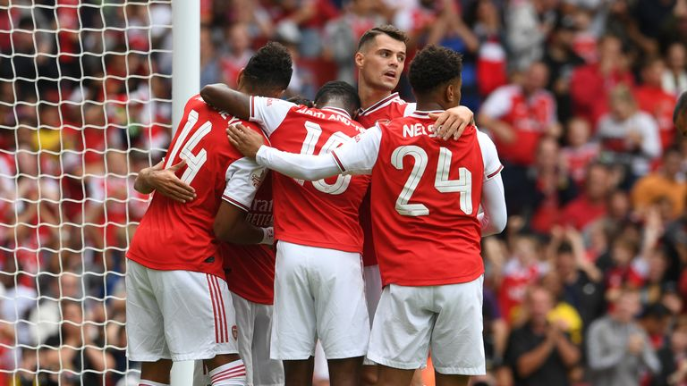 Arsenal players celebrate their opener at the Emirates
