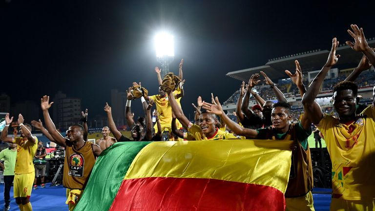 Benin players celebrate after qualifying for the round of 16