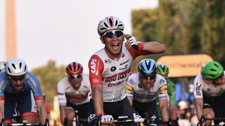 Caleb Ewan celebrates winning the final stage on the Champs-Elysees