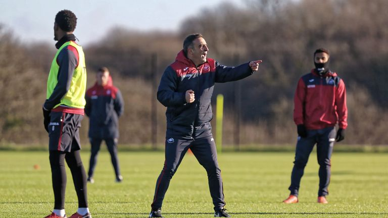 SWANSEA, WALES - DECEMBER 28: Manager Carlos Carvalhal gives instructions to his players during the Swansea City Training at The Fairwood Training Ground on December 28, 2017 in Swansea, Wales. (Photo by Athena Pictures/Getty Images)