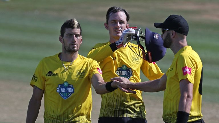 Benny Howell (left) celebrates a wicket with Gloucestershire team-mates Gareth Roderick and Andrew Tye