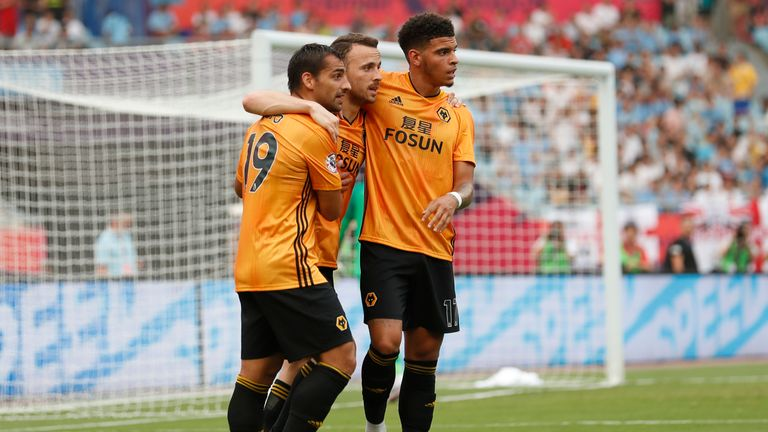 NANJING, CHINA - JULY 17: Diogo Jota #18 of Wolverhampton Wanderers celebrates after scoring his team's goal during Premier League Asia Trophy - Newcastle United v Wolverhampton Wanderers on July 17, 2019 in Nanjing, China. (Photo by Fred Lee/Getty Images for Premier League)