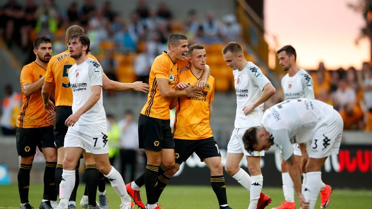Diogo Jota is congratulated after firing Wolves into the lead