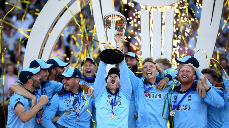 Eoin Morgan lifts the trophy as England celebrate winning the 2019 Cricket World Cup