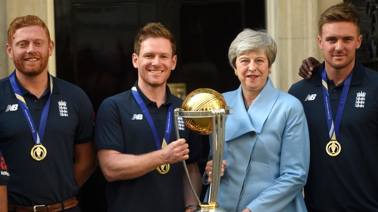 Eoin Morgan and Theresa May with the Cricket World Cup trophy