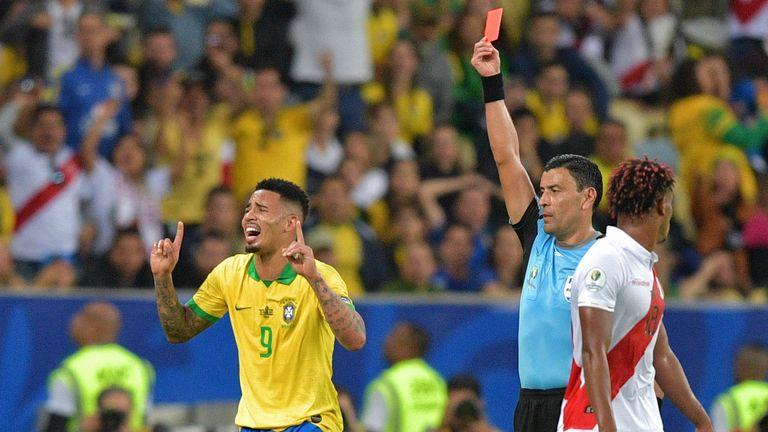Gabriel Jesus is shown the red card after picking a second yellow in the Copa America final