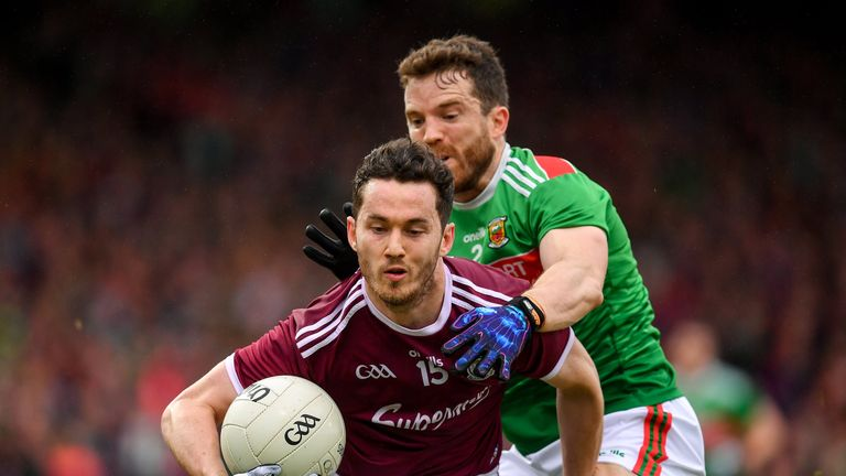 Ian Burke of Galway in action against Chris Barrett of Mayo
