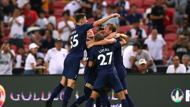Harry Kane is mobbed by team-mates after scoring from near the halfway line against Juventus