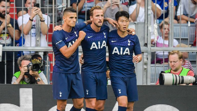 Harry Kane celebrates with Erik Lamela and Heung-Min Son after scoring against Real Madrid