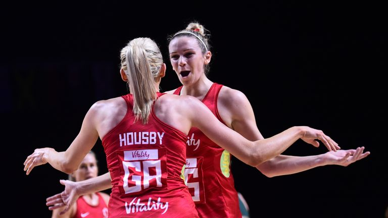 Helen Housby and Jo Harten teamed up again to give England sixth victory at the Netball World Cup and a semi-final against New Zealand.