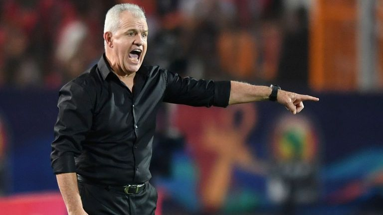 Egypt's coach Javier Aguirre speaks to his player sduring the 2019 Africa Cup of Nations (CAN) Round of 16 football match between Egypt and South Africa at the Cairo International Stadium in the Egyptian Capital on July 6, 2019.