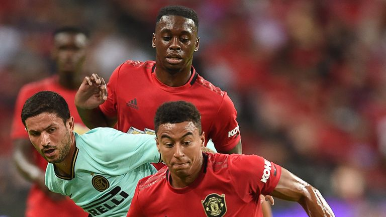 Manchester United's Jesse Lingard (front) runs after the ball during the International Champions Cup football match between Manchester United and Inter Milan in Singapore on July 20, 2019. (Photo by Roslan RAHMAN / AFP) (Photo credit should read ROSLAN RAHMAN/AFP/Getty Images)