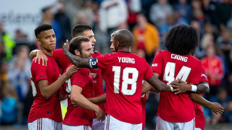 Juan Mata celebrates scoring with Manchester United team-mates against Kristiansund