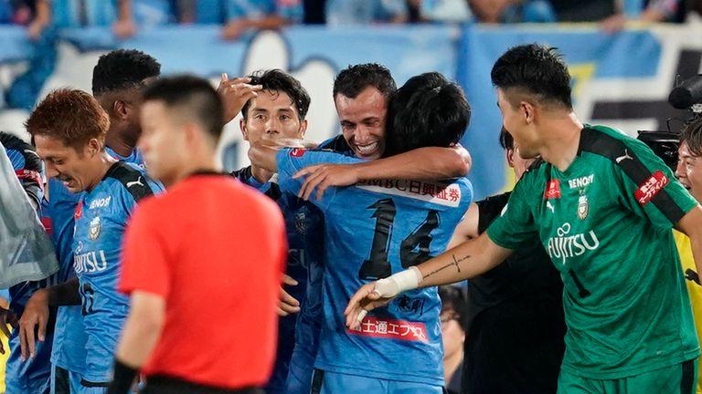 Damiao (centre) celebrates his late winner