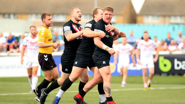 London Broncos' Luke Yates celebrates wtih his team-mates after he scores against St Helens