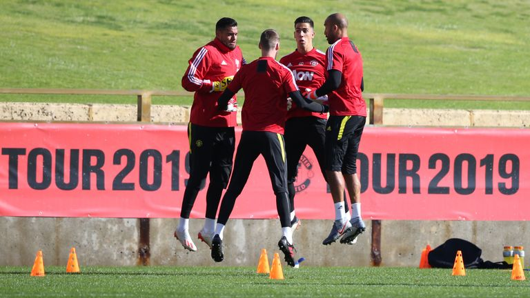 Manchester United's goalkeepers jump into action during pre-season training