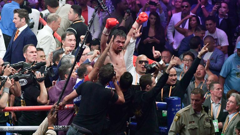 LAS VEGAS, NEVADA - JULY 20. .Manny Pacquiao waves to his fans after going 12 rounds with Keith Thurman during their fight for the WBA welterweight title fight at MGM Grand Garden Arena on July 20, 2019 in Las Vegas, Nevada. Pacquiao took the win by a split decision.  (Photo by Gene Blevins/Getty Images)........