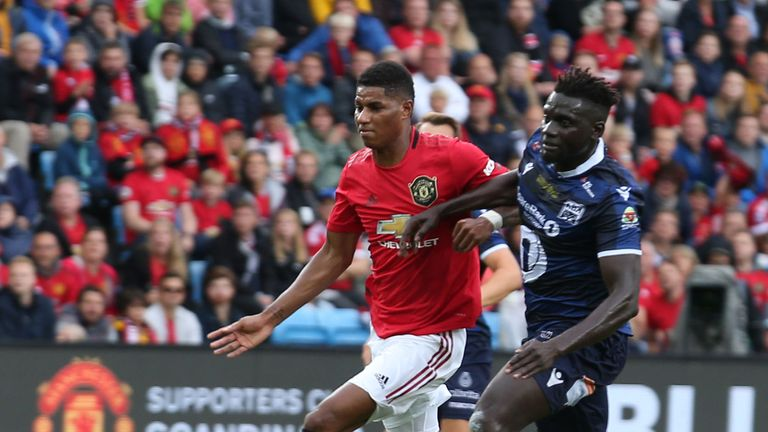 Marcus Rashford is challenged by Kristiansund's Aliou Coly