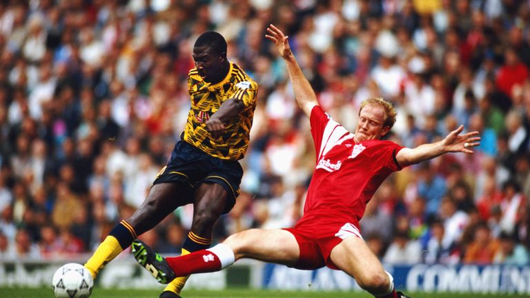 Wright tackles Arsenal's Kevin Campbell during his Liverpool days