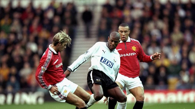 Derby County's Marvin Robinson contests the ball with Manchester United's David Beckham