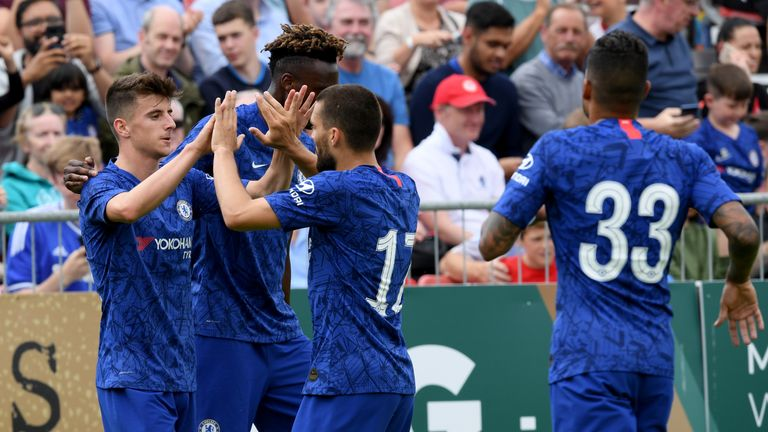 DUBLIN, IRELAND - JULY 13: Mason Mount of Chelsea celebrates with his teammates after scoring his sides first goal during the Pre-Season Friendly match between St Patrick's Athletic FC and Chelsea FC at Richmond Park on July 13, 2019 in Dublin, Ireland. (Photo by Darren Walsh/Chelsea FC via Getty Images)
