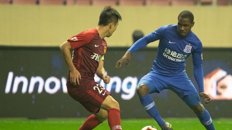 Odion Ighalo taking on a defender while playing for Shanghai Shenhua
