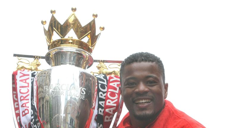 Patrice Evra with the Premier League trophy on May 30, 2011 in Manchester, England.
