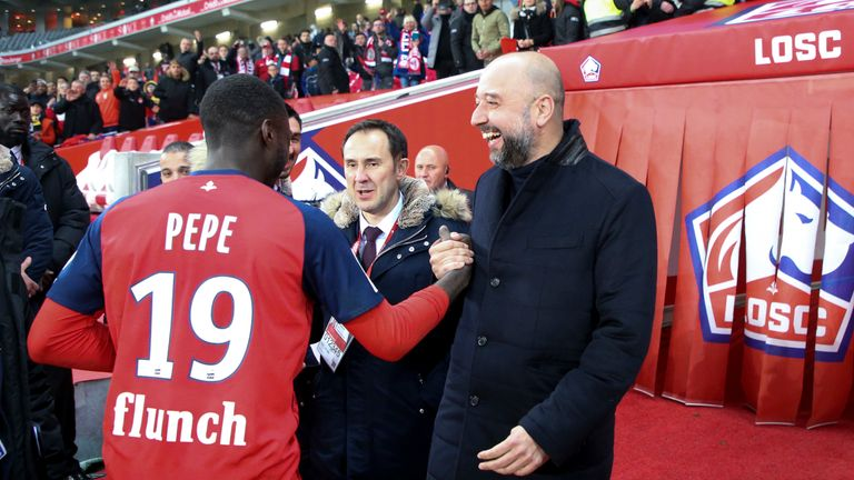LILLE, FRANCE - APRIL 14: President of Lille Gerard Lopez congratulates Nicolas Pepe of Lille following the French Ligue 1 match between Lille OSC (LOSC) and Paris Saint-Germain (PSG) at Stade Pierre Mauroy on April 14, 2019 in Lille, France. (Photo by Jean Catuffe/Getty Images)
