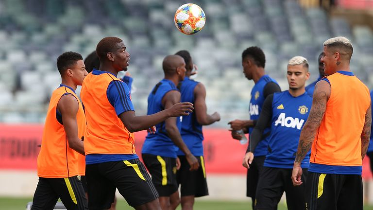Paul Pogba keeps eyes on the ball during Manchester United training