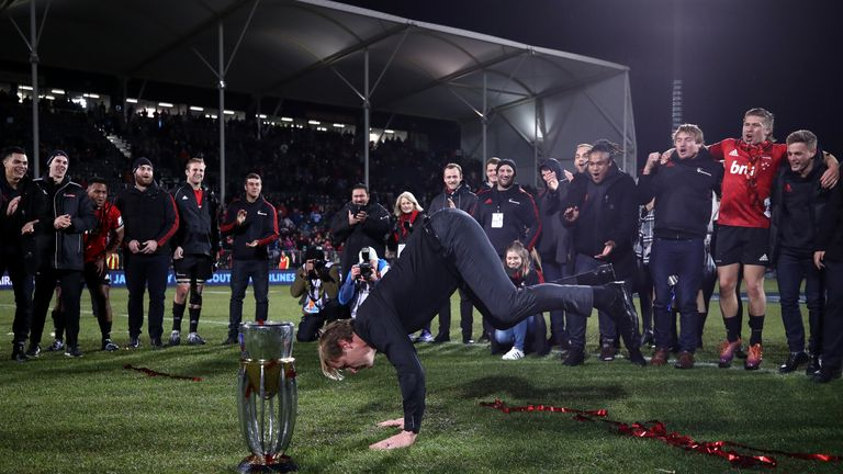 Crusaders coach Scott Robertson dances alongside the Super Rugby Trophy after winning the Super Rugby Final between the Crusaders and the Jaguares at Orangetheory Stadium on July 06, 2019 in Christchurch, New Zealand.