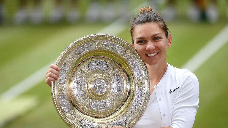 Simona Halep proudly displays the Venus Rosewater Dish