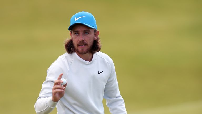 England's Tommy Fleetwood celebrates a putt during day three of The Open Championship 2019 at Royal Portrush Golf Club.