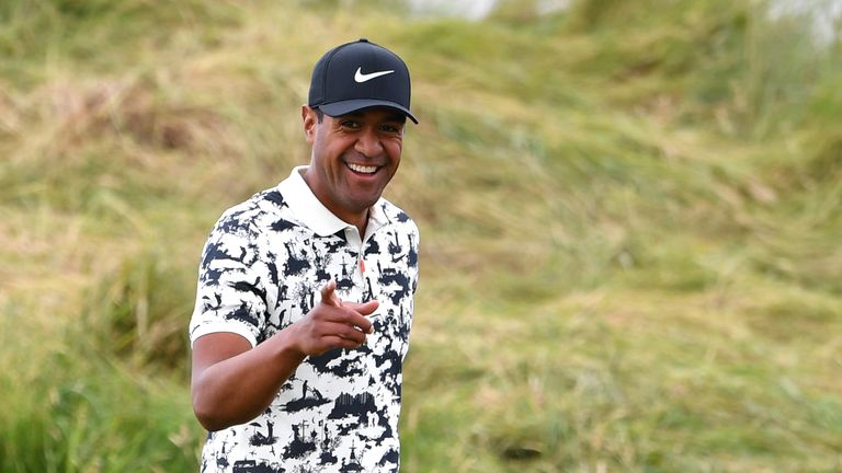 US golfer Tony Finau smiles at spectators on the 1st hole during the third round of the British Open golf Championships at Royal Portrush golf club in Northern Ireland on July 20, 2019. (Photo by Paul ELLIS / AFP) / RESTRICTED TO EDITORIAL USE (Photo credit should read PAUL ELLIS/AFP/Getty Images)