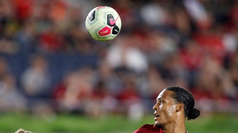 Liverpool defender Virgil van Dijk battles for the ball with Bruun Larsen