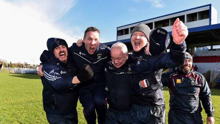 The backroom team celebrate their National League promotion earlier this year