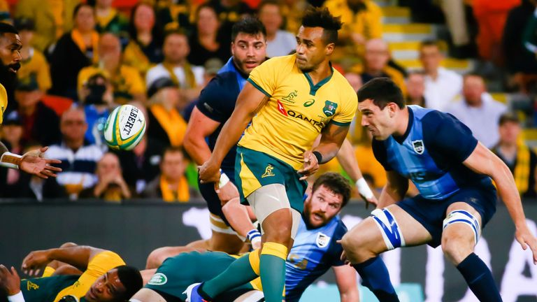 Will Genia looks for the inside flick pass