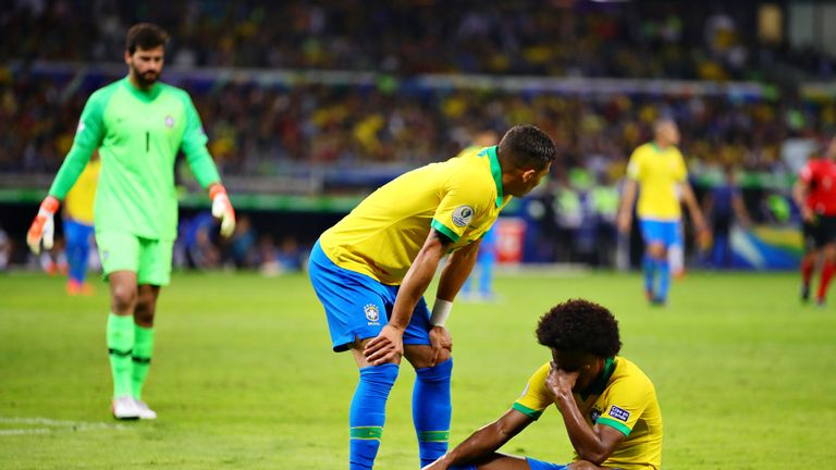 Brazil forward Willian sits on the floor after suffering an injury in the Copa America semi-final win over Argentina