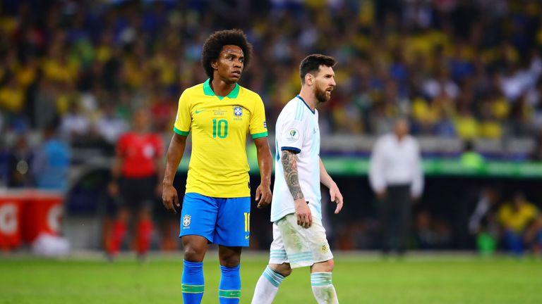 Willian of Brazil and Lionel Messi of Argentina pictured in the Copa America semi-final