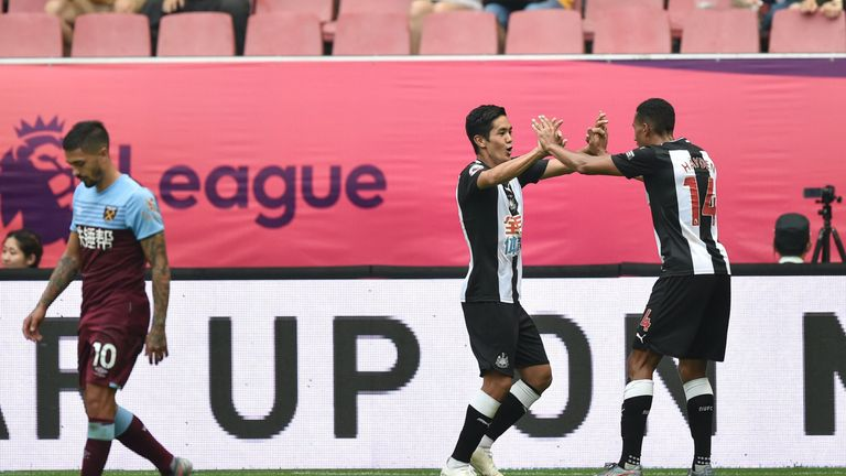 Newcastle United's Yoshinori Muto (C) celebrates his goal against West Ham during their match for the third place at the 2019 Premier League Asia Trophy football tournament at the Hongkou Stadium in Shanghai, on July 20, 2019. (Photo by HECTOR RETAMAL / AFP) (Photo credit should read HECTOR RETAMAL/AFP/Getty Images)