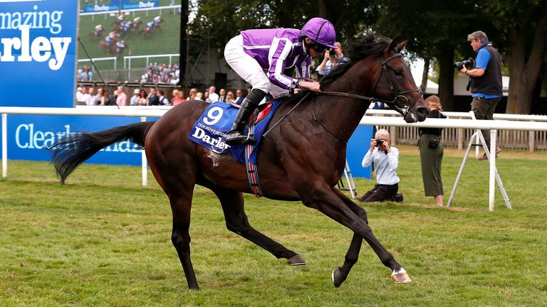 Ten Sovereigns ridden by jockey Ryan Moore on their way to victory in the Darley July Cup Stakes