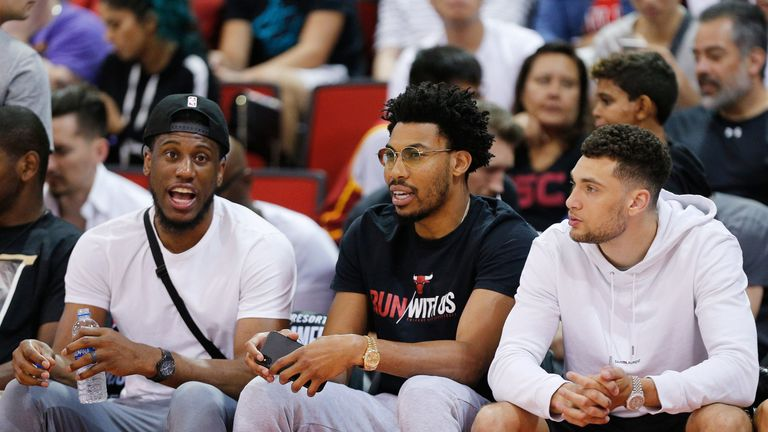 LaVine (right) takes in a Summer League game with Bulls team-mates Thaddeus Young and Otto Porter Jr