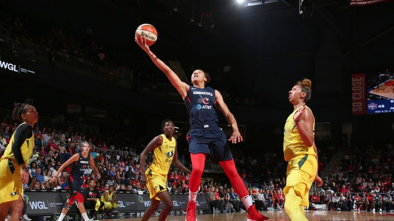 Aerial Powers rises to score against the Seattle Storm