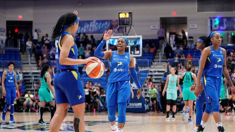 Allisha Gray celebrates a play against the New York Liberty