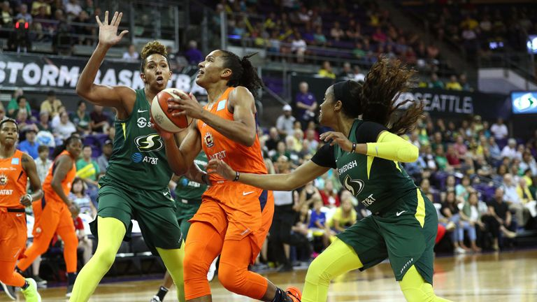 Alyssa Thomas drives to the basket against the Seattle Storm