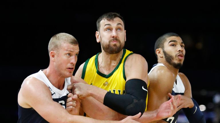 Andrew Bogut outmuscles Mason Plumlee and Jayson Tatum at the Marvel Stadium in Melbourne